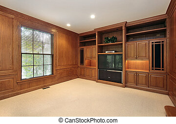 Family room with wood cabinetry - All wood family room in...