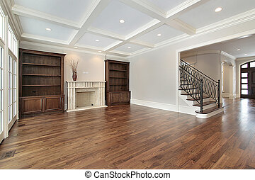 Family room in new construction home with cherry floors