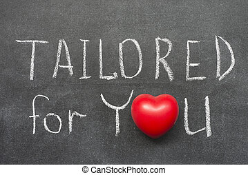 tailored for you phrase handwritten on blackboard with heart...