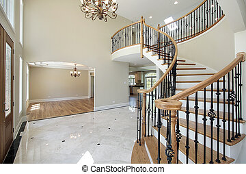 Foyer in new construction home with view into dining room