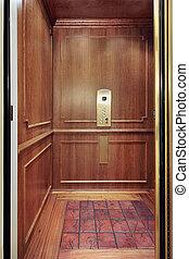 Elevator in luxury home - Elevator with floor design in...