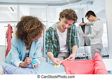 Students working together with a fabric at the college