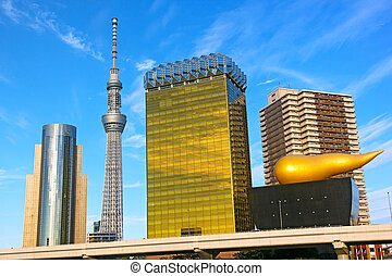 Landmark buildings line along Sumida River in Asakusa in...