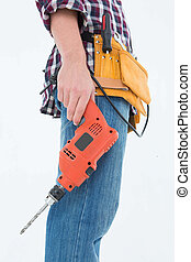 Male handyman holding drill machine - Side view of male...
