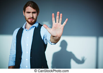 Stop - Young businessman showing stop gesture