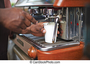 Making hot drink - Hands of seller using coffee machine