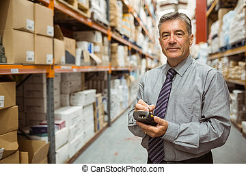 Smiling male manager using handheld