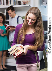 Student carrying small pile of books