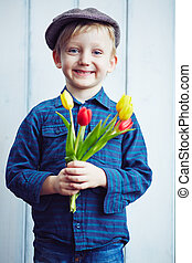 Handsome boy - Cute little boy with bunch of red and yellow...