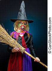Scary witch with colored skin on dark background