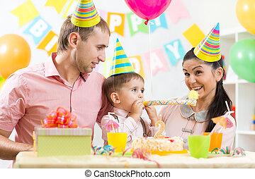 family celebrating kid's birthday