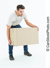 Courier man picking up cardboard box - Full length of...