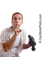Shhh - A young man is telling the viewer to be quiet while...