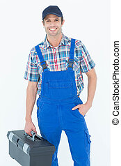 Confident plumber carrying tool box - Portrait of confident...