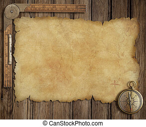 old treasure map on wooden desk with compass and ruler -...