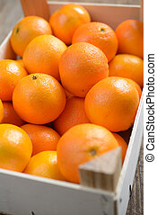 Mandarin oranges in a box. Shallow DOF