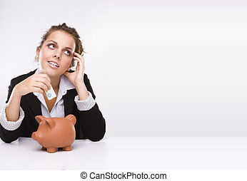 Savings - Business woman at work holding English pound...