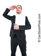 Smiling businessman looking and holding laptop on white...