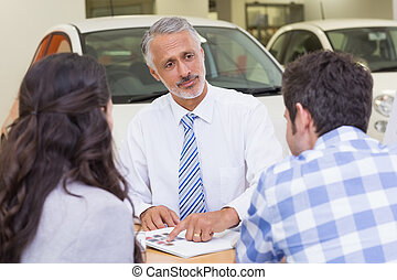 Salesperson pointing something on booklet
