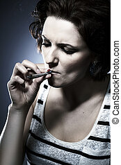 Marijuana smoke consumer - young lady - Young woman on...