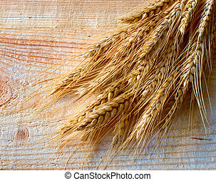 wheat ears on the old wooden background