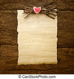 Valentine's Day or wedding parchment paper on wooden...