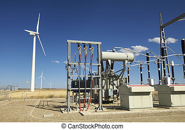 power plant - high-voltage substation and windmill with blue...