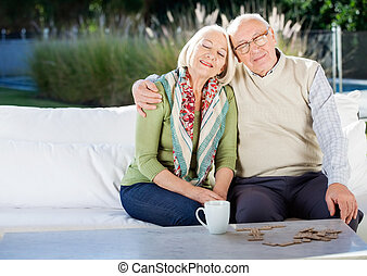 Relaxed Senior Man Sitting On Couch At Nursing Home Porch -...