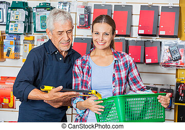 Customer With Worker In Hardware Shop