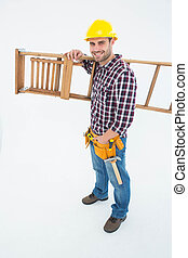 Confident handyman carrying ladder - Full length portrait of...
