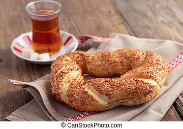Simit and tea - Turkish bagel, simit, and traditional tea on...