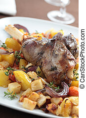 Goose leg with vegetables