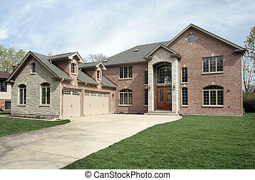 New construction brick home with stone entryway