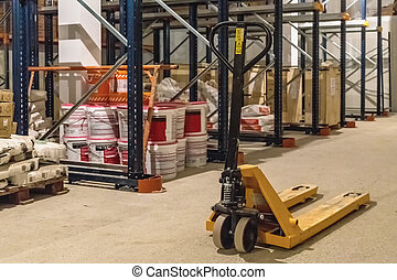 Manual forklift pallet stacker truck equipment in warehouse