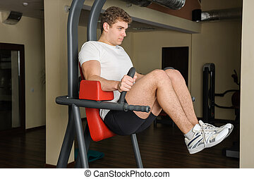 young man doing lats pull-down workout - Handsome young man...