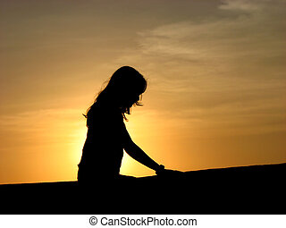 Morning Meditation - A silhouette of a hindu woman...