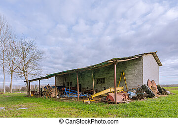 Shed for farm implements - old shelter for agricultural...