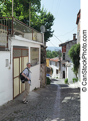 Tourist in Turkish town - Tourist with backpack on a narrow...