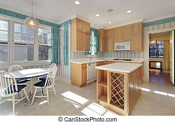 Kitchen in home for sale - Kitchen with wood cabinets and...