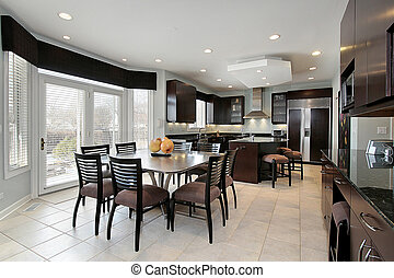 Kitchen with dark paneling - Kitchen in luxury home with...