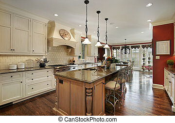 Kitchen with marble island countertop - Kitchen in luxury...