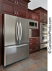 Close up of kitchen cabinets and refrigerator