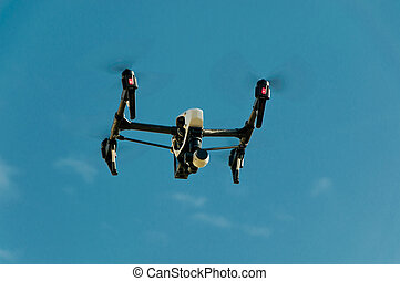 Drone in sky - Unmanned Aerial Vehicle drone in flight sky