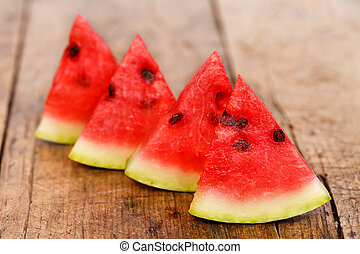 Pieces of watermelon on the table - Four pieces of fresh...