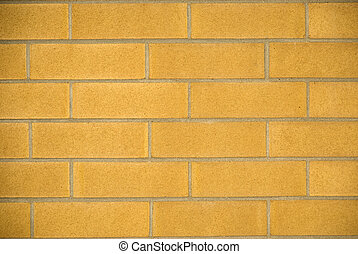 Yellow brick wall - a texture and background pattern