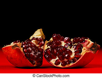 Pieces of grenadine over red and dark background