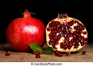 Pomegranates side by side - Two grenadines side by side on...