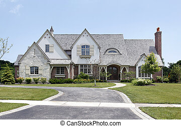 Brick home in suburbs with cedar shake roof