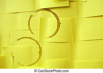 coffee stains on yellow paper