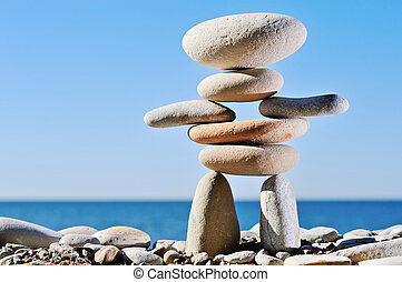 Figurine - Sculpture symbol of different pebble against a...